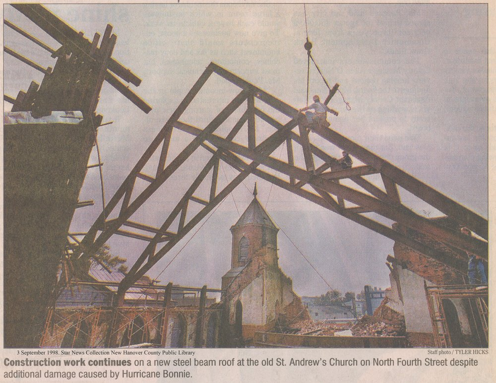 """Construction work continues on a new steel beam roof at the old St. Andrew's Church on North Fourth Street despite additional damage caused by Hurricane Bonnie."" -Star News, September 1998  Photo Courtesy New Hanover County Public Library"