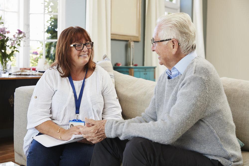 female-support-worker-visits-senior-man-at-home-PQPXTEL.jpg