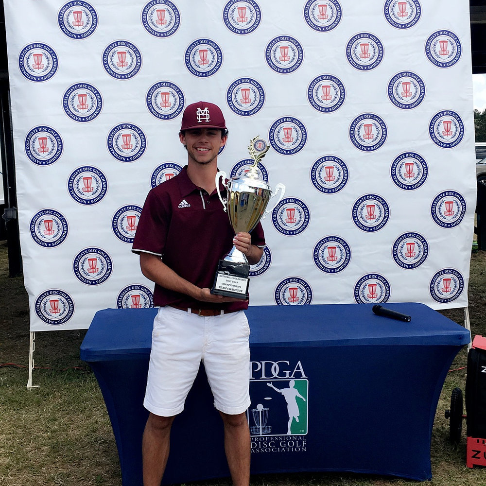 Jacob Henson celebrating his team's victory at the National Collegiate Disc Golf Championship.