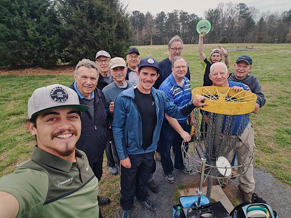 Matt Versola, Austin Lytle and Dylan Holt teaching seniors Disc Golf.