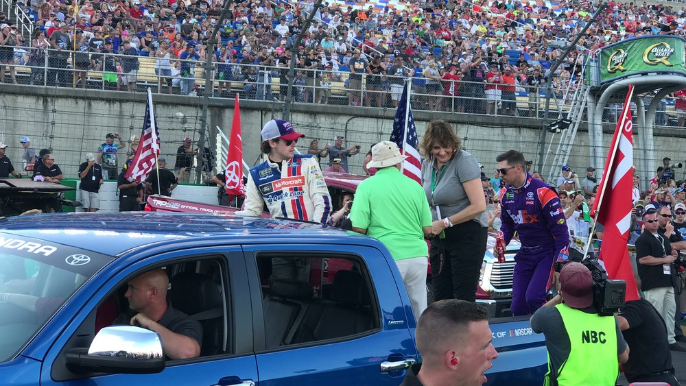 Guests join the parade lap with professional NASCAR drivers.