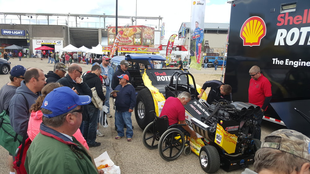 Crowds are a sure thing when Larry Koester is out working on his tractor.