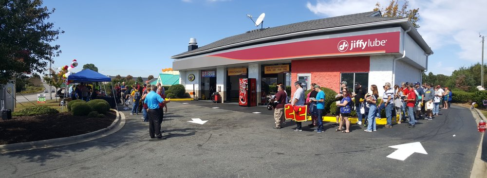 The line to meet Joey Logano wraps around the Jiffy Lube in Mooresville, NC.