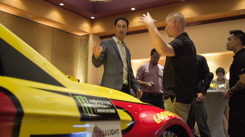Guests learn how Pennzoil technology translates to on-track performance.