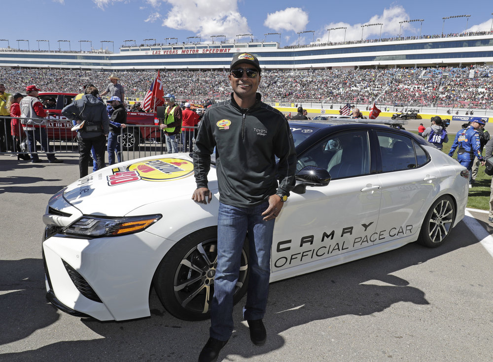Antron Brown drives the pace car for the Pennzoil 400