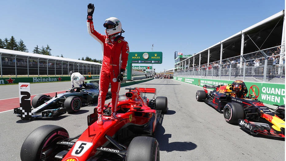 Sebastian Vettel celebrates after securing pole for the race. He would go on to win the event, his 50th win, 40 years after Shell and Ferrari's first win in Montreal.