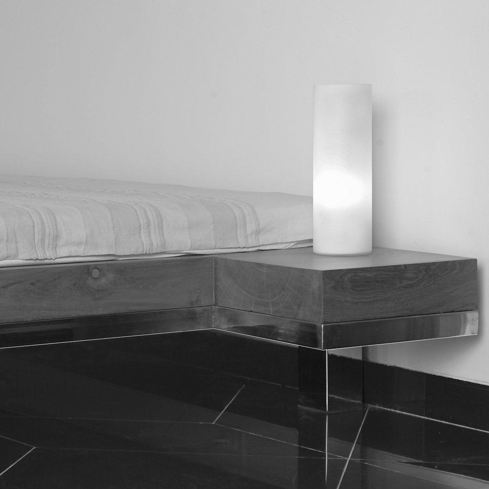 Platform bed in reclaimed teak wood and polished stainless steel.   Bett aus gebrauchtem Teakholz und poliertem, rostfreiem Stahl.