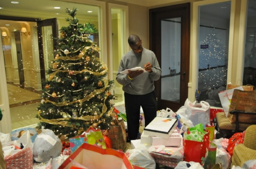 Previous CAPTRUST Community Foundation President Kevin Monroe volunteers his time to review last year's donations from CAPTRUST employees to Salvation Army Angel Tree kids. The Angel Tree donation drive was organized by the Foundation.