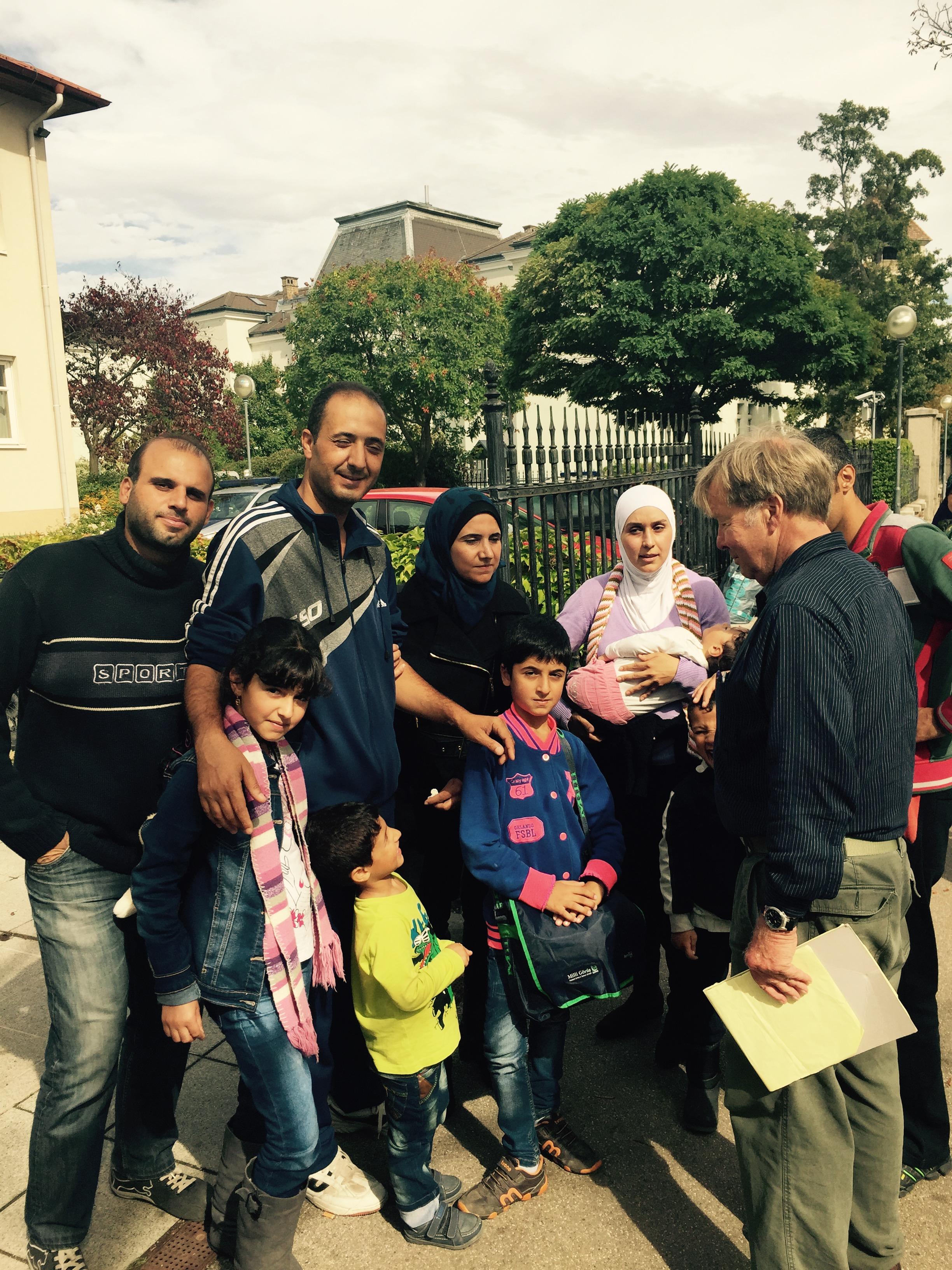 DeWitt talks to the Jasam family