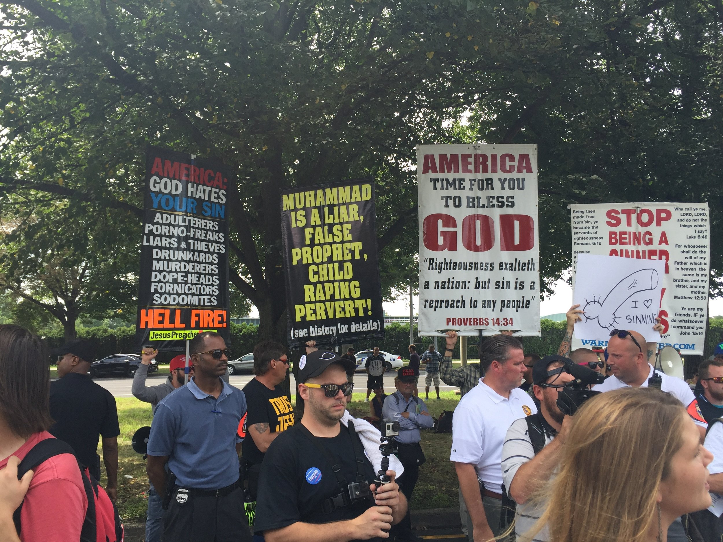 """Sinners, it's even hotter in hell than Philadelphia."" These guys lugged their signs, bullhorn and bellicose Christianity all the way from Cleveland."
