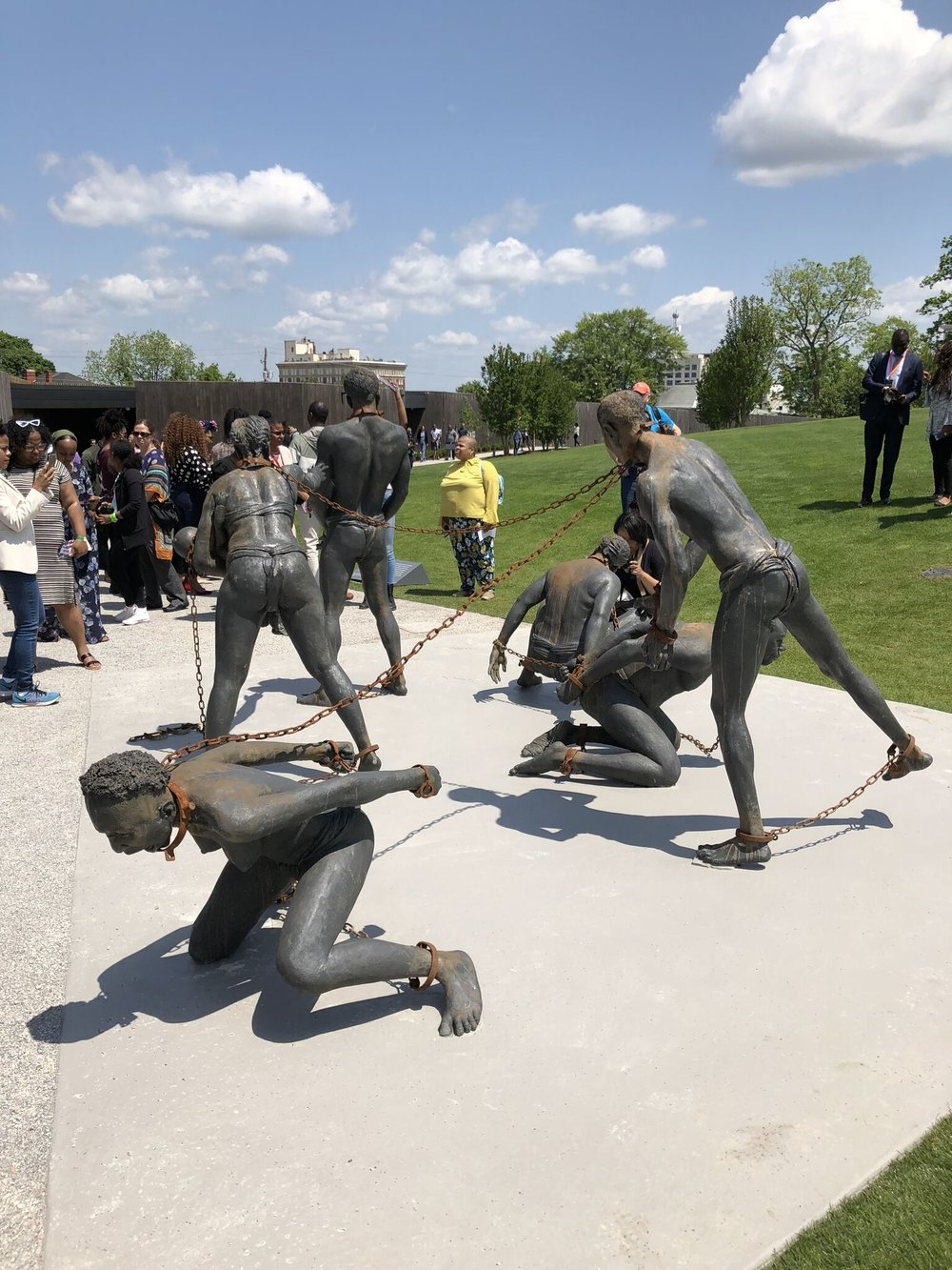 A sculpture by Kwame Akoto-Bamfo confronts visitors as they enter The National Memorial for Peace and Justice. (Photo by Jamie Blaine)