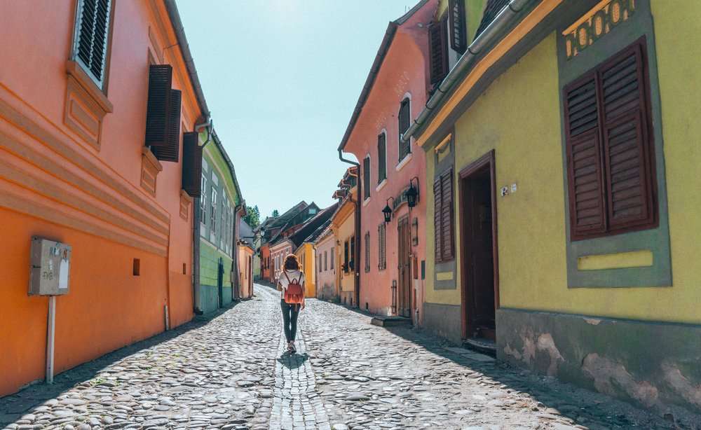 Sighisoara's hilly cobbled streets, colorful medieval buildings, steep stairways, stone defensive towers and little squares make it a delightfully photogenic and fascinating place to stroll.