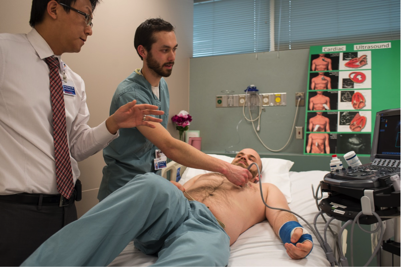 Justin Chen M.D. (R1) performing bedside ECHO to assess LV function.