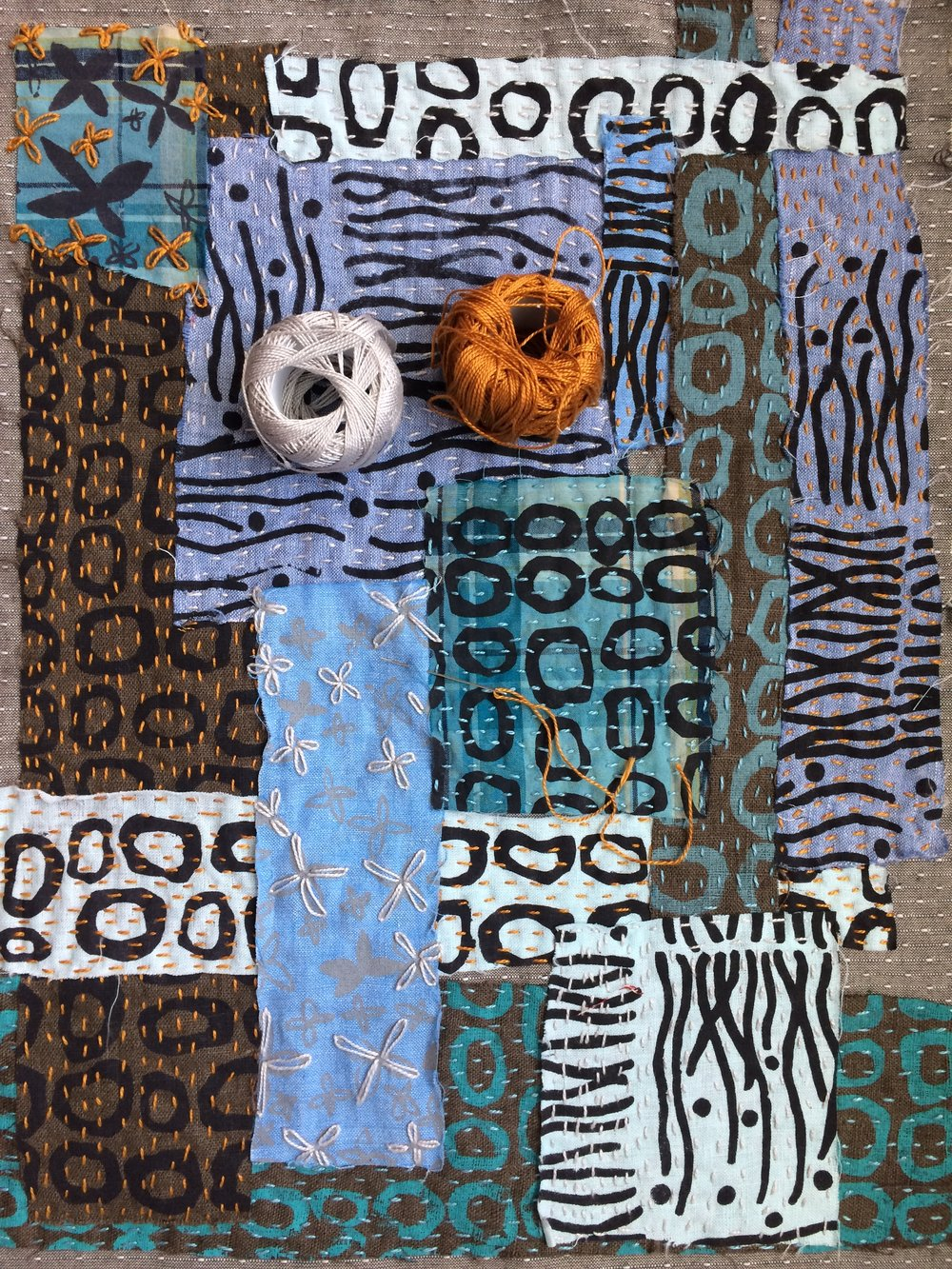 My printed fabrics collaged using #10 Pearl cotton