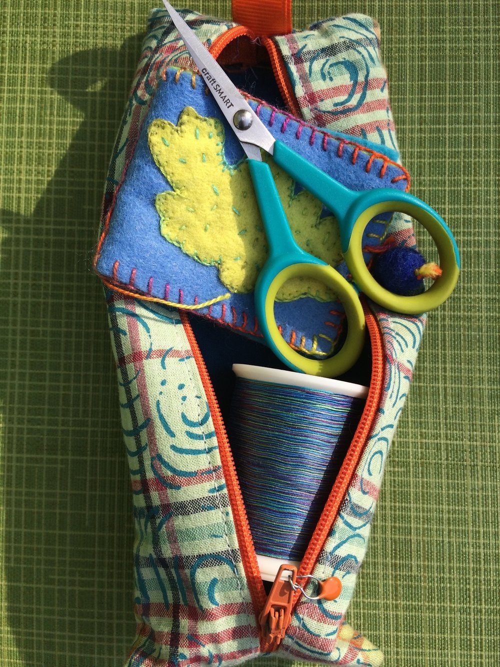 My portable stitch kit. (Needles live inside the felt folder, also handmade by me.)