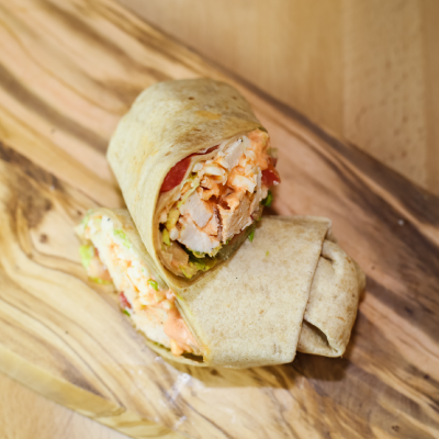 Buffalo Chicken WrapSpicy chicken breast with shredded lettuce, diced tomatoes, and mozzarella cheese drizzled with a creamy buffalo sauce on a honey wheat tortilla.$6.49 - 621 Calories | 55 g Protein | 59 g Carbs | 18 g Fat