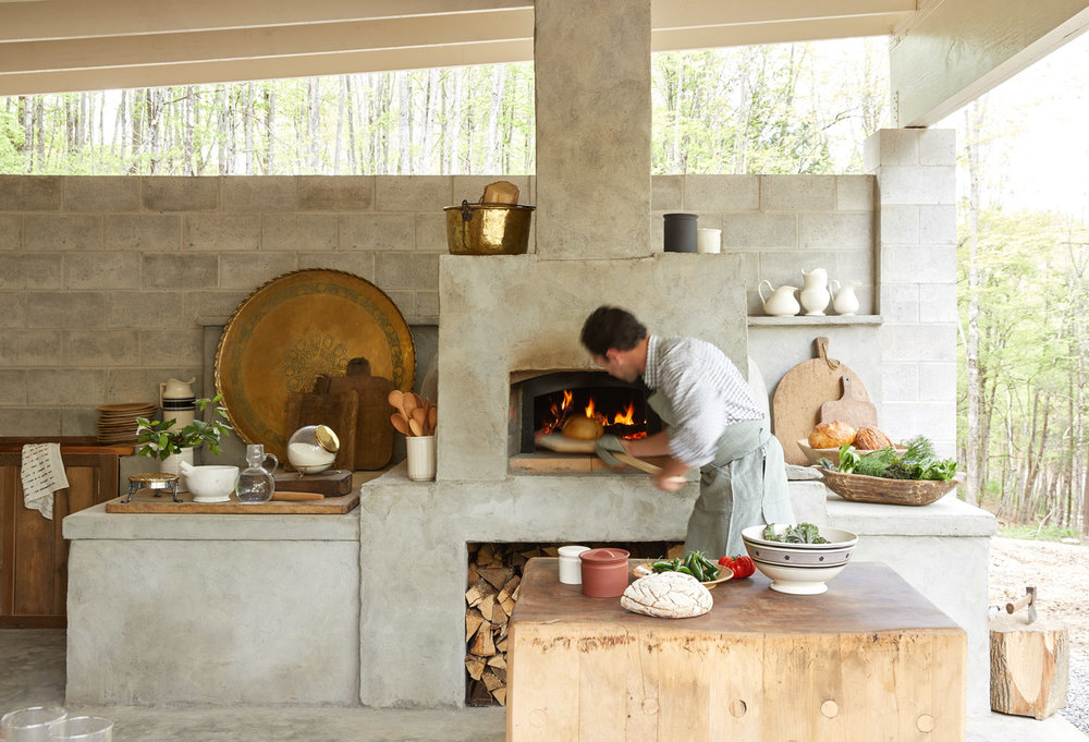 Chef Philip Kubaczek in the outdoor kitchen at Here Here  (Photo by Kate Sears)