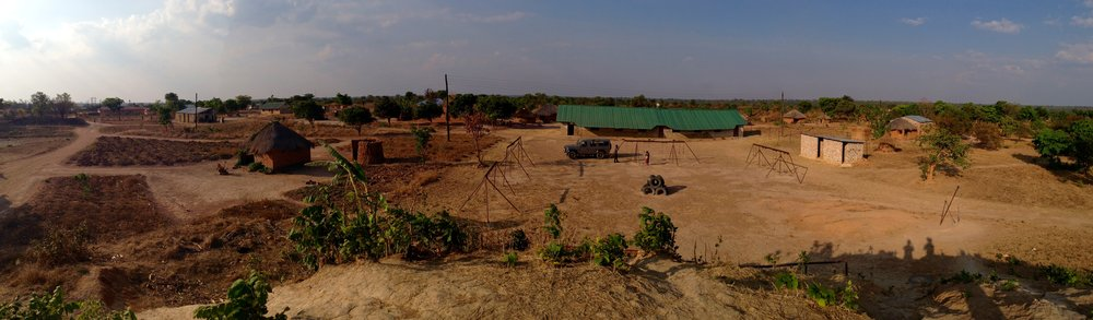 panorama of the procured property. the green roof is the main classroom block already in use.