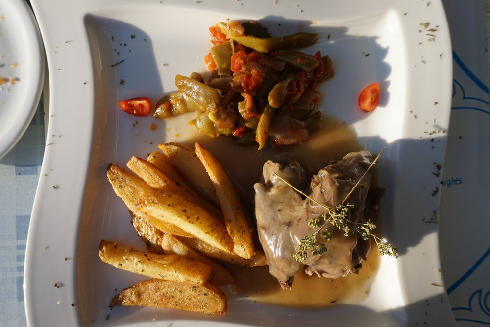 Oven-baked lamb served with chips (divine, by the way... served with a sprinkling of herbs, salt, and pepper)