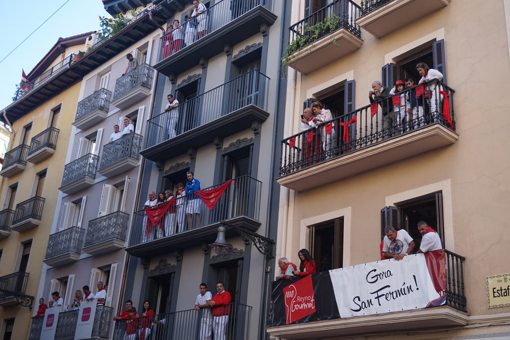 Locals enjoying the festivities from their balconies