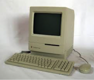 The original Apple Macintosh that pioneered the widespread use of graphical interface and mouse in personal computing.