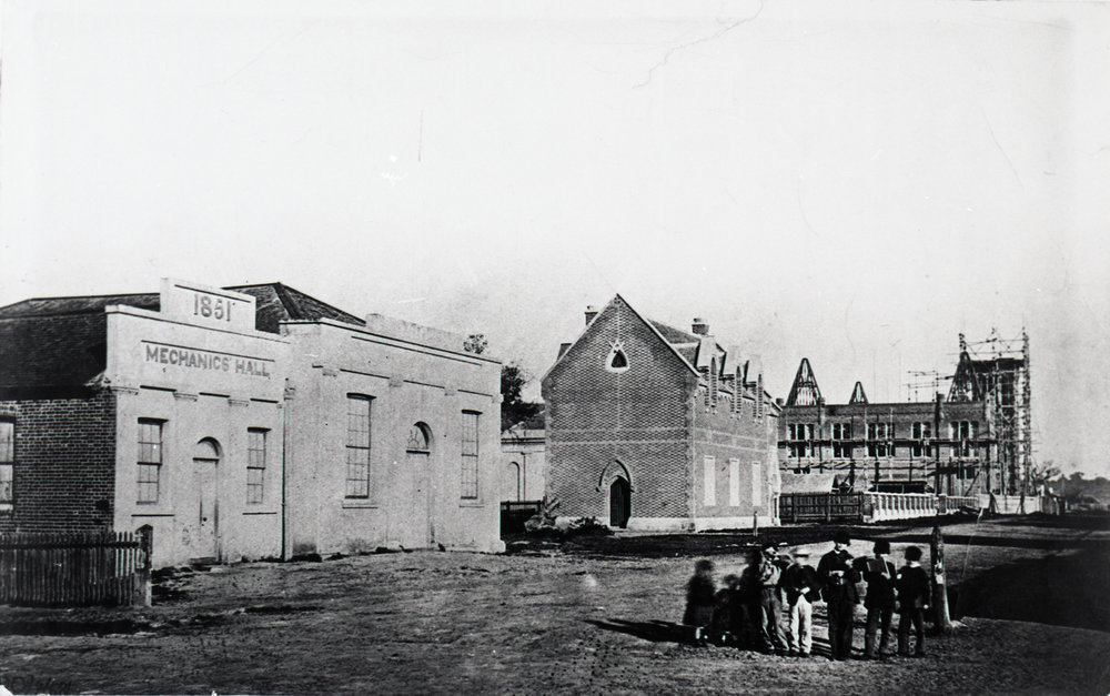 Looking west up Hay Street, Perth, with Swan River Mechanics' Institute on left and partially completed Town Hall on right, 1868. Photo courtesy of City of Perth History Centre Collection