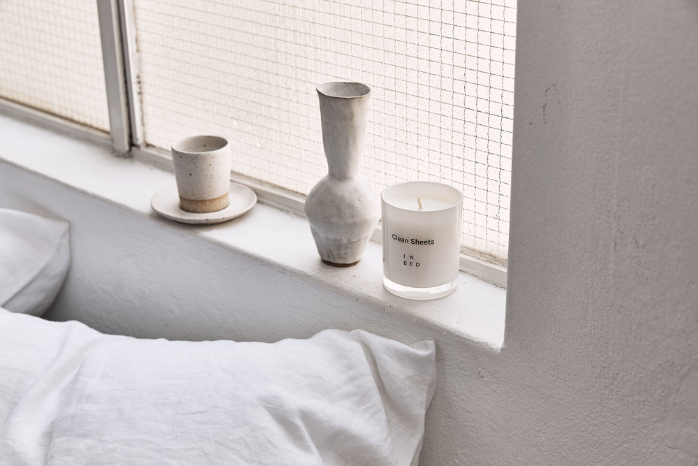 A collection of ceramics made by  Wingnut & Co  and the  Clean Sheets Candle .