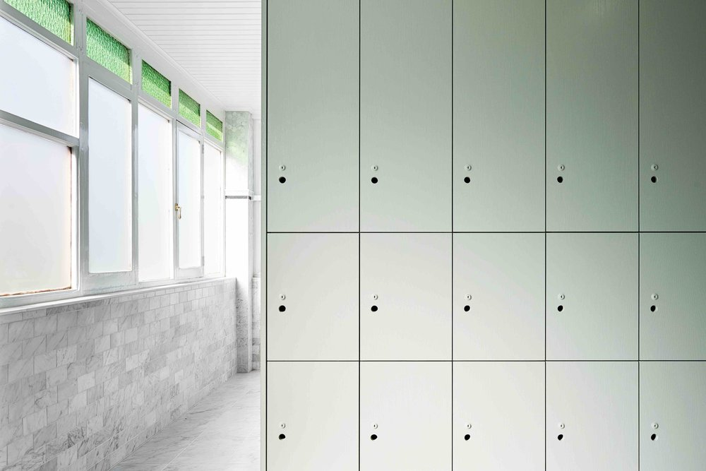 Marble tiles line the floors and walls of the change rooms.