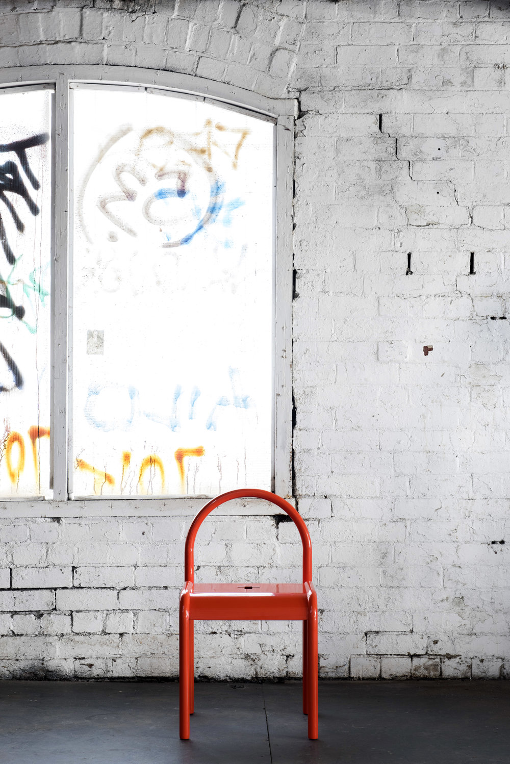 The bright and beautiful  Halo  chair in bold powder-coated red. Photo - Nicole England.