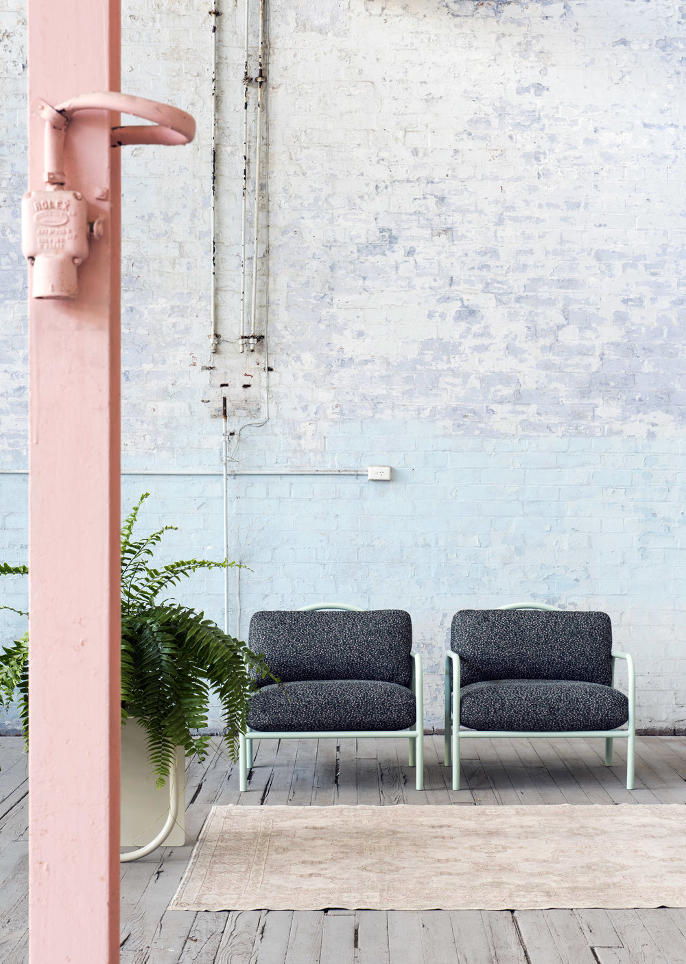 The  Halo  Easy Armchair in peppermint green frame and black upholstery. Photo - Nicole England.
