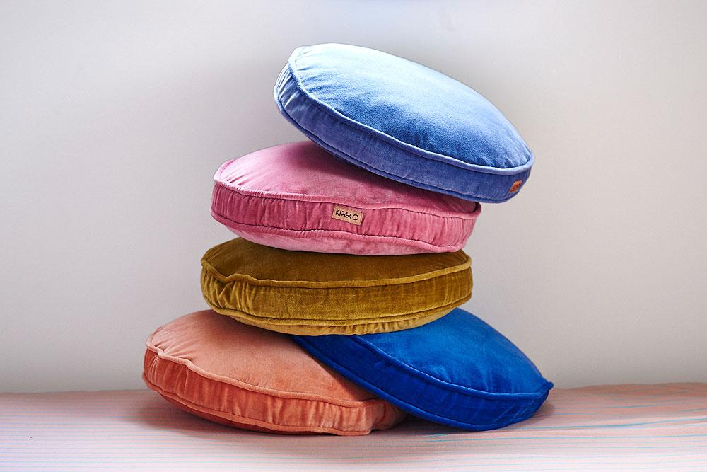 Kip&Co's  luscious velvet round cushions in a rainbow of colours.