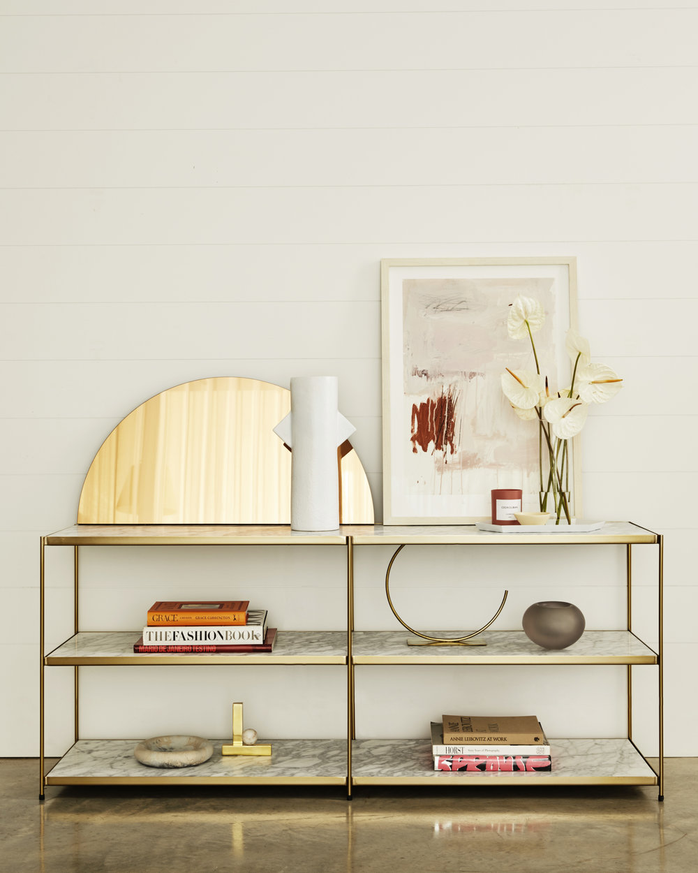 Our absolute favourite piece - the   Long Low   shelf, three layers of marble within a streamline brushed brass frame.