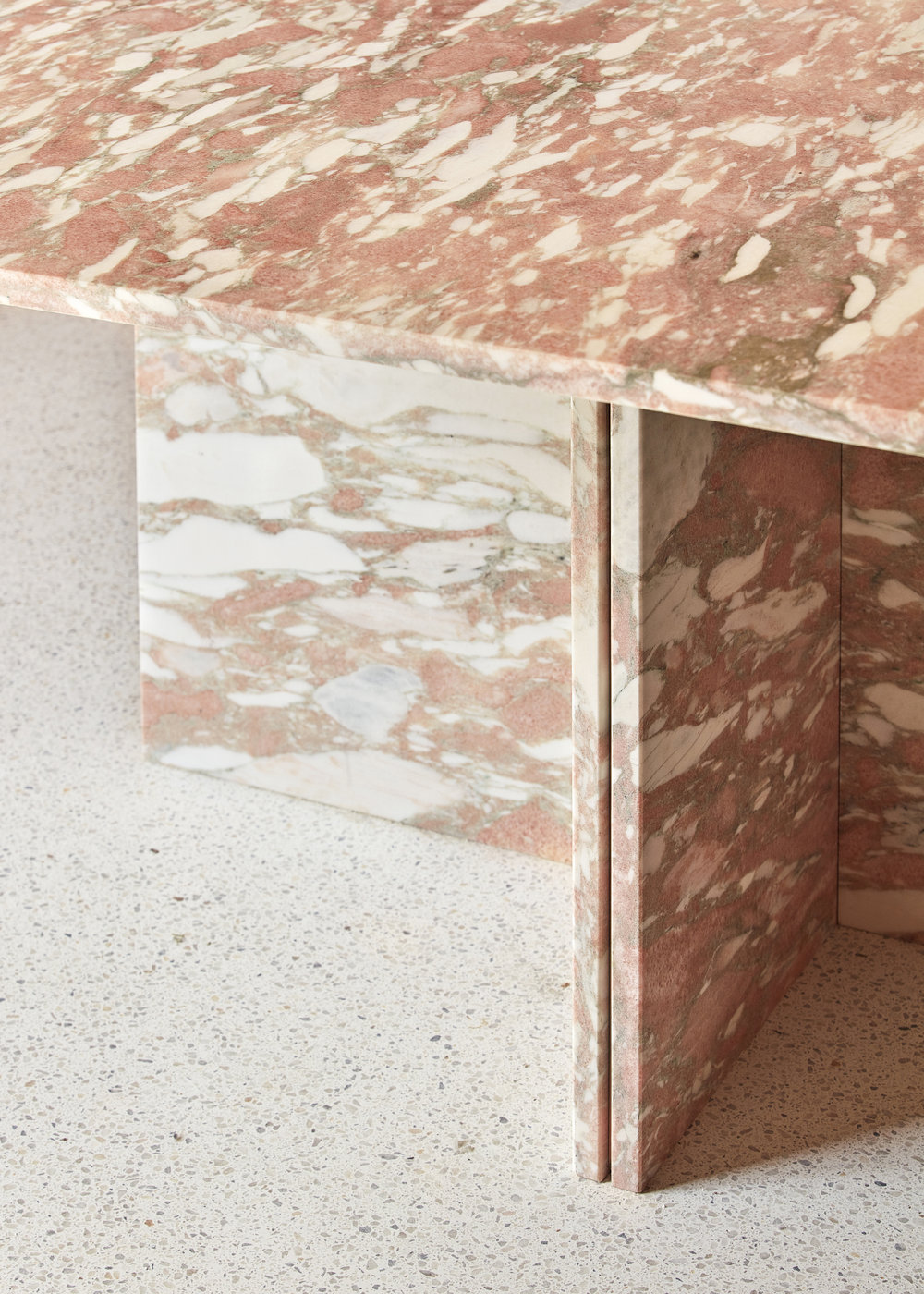 The beautiful Norwegian rose marble display counter against the white terrazzo.