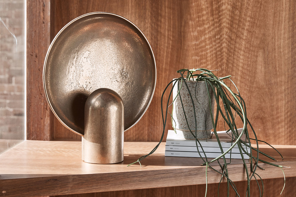 Our personal favourite - the incredible bronze sconce lamp by  Henry Wilson . Photo – Terence Chin.