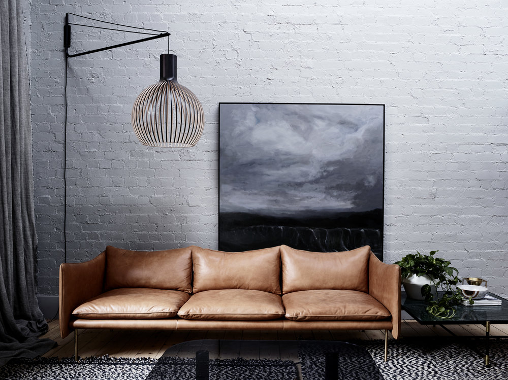 Tiki three-seat sofa designed by Andreas Engesvik for Fogia, Sweden. Varsi arm and Octo pendant by Secto Design, Finland. Coffee Table 90 with brass details by Händvark, Denmark. Photo – Mark Roper. Styling – Simone Haag.