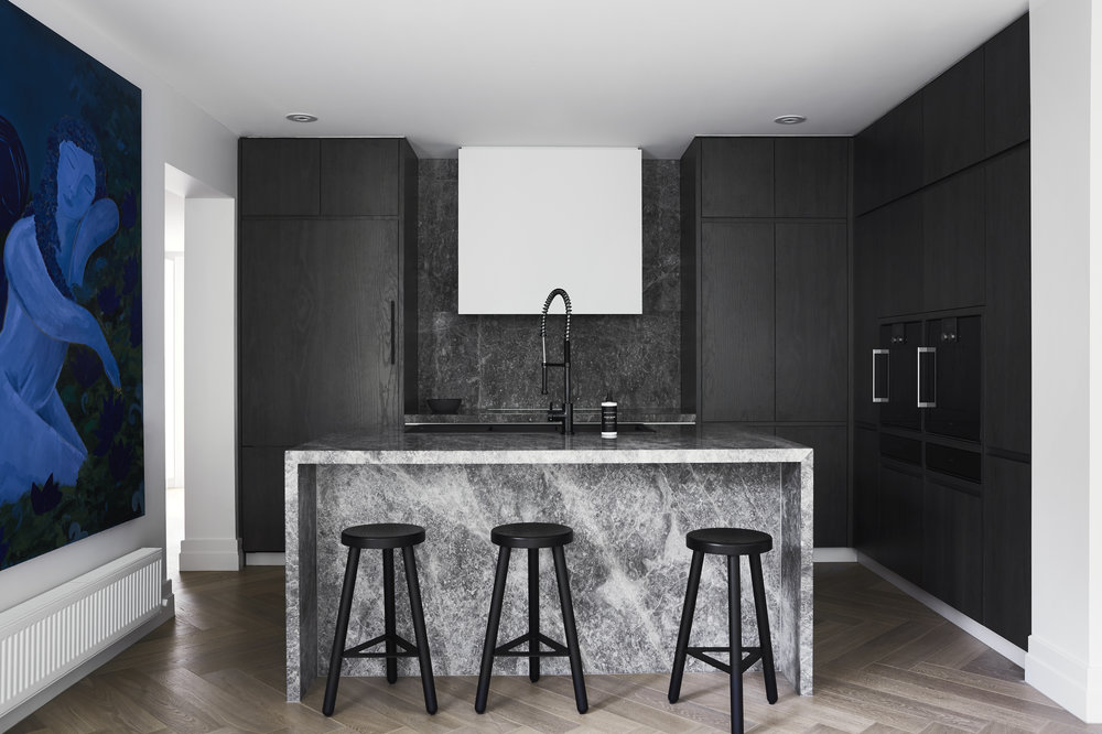 The moody kitchen in Toorak House designed by  Studio Griffiths . Photo - Sharyn Cairns.