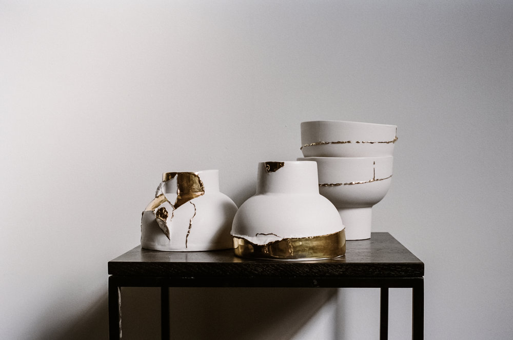 Milly Dent's new pieces combine raw clay, gloss glaze and ethereal gold lustre. Photo –  Kelly Geddes .