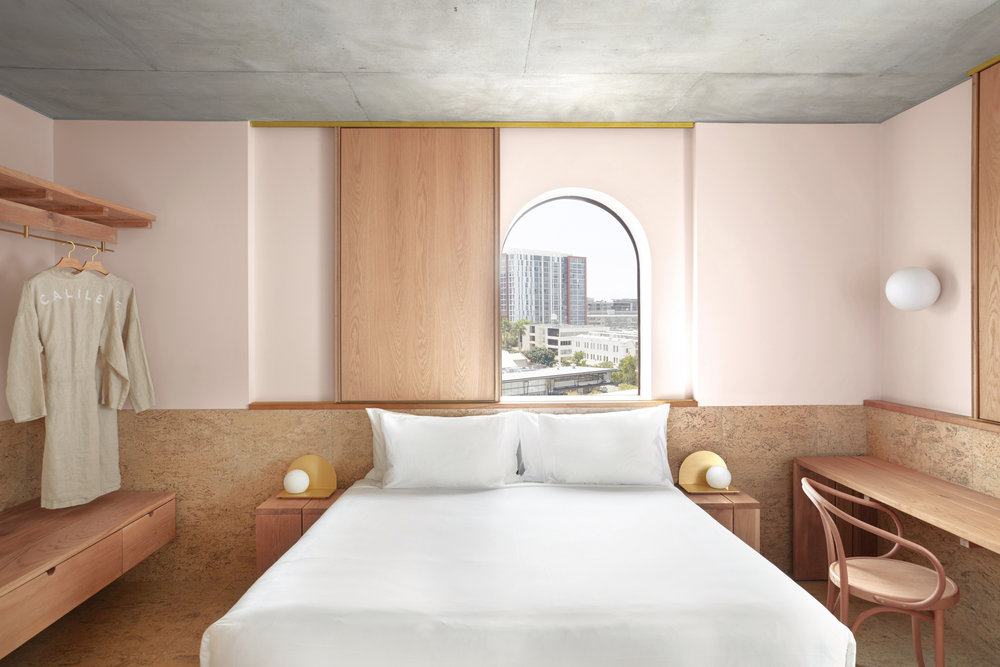 Natural pink blush walls and the blonde timber joinery in  The Calile Hotel . Photo - Sean Fennesy.