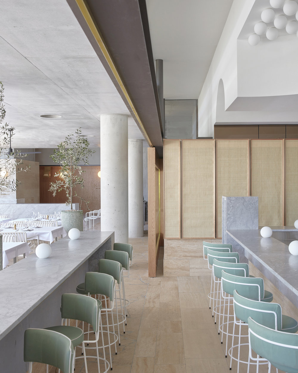 Muted blues and greens in the hotel restaurant in the  The Calile Hotel  designed by  Richards and Spence . Photo - Sean Fennesy.
