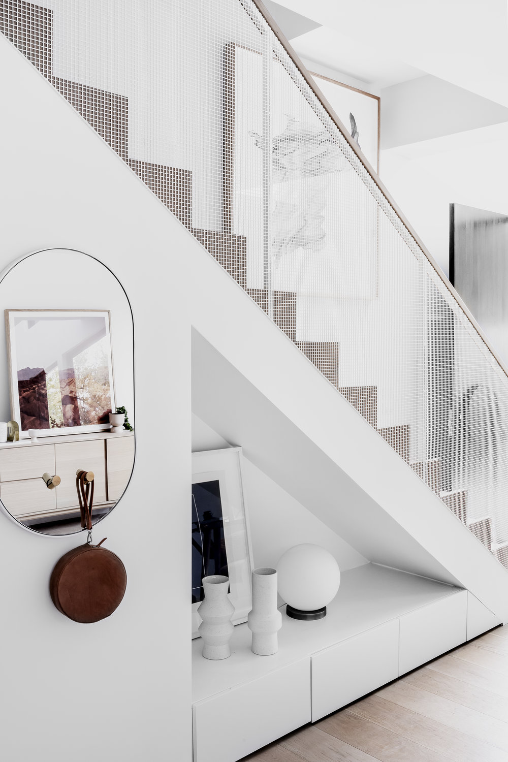 The perforated staircase detail - letting in light and connecting the spaces. Photo -  Maegan Brown .