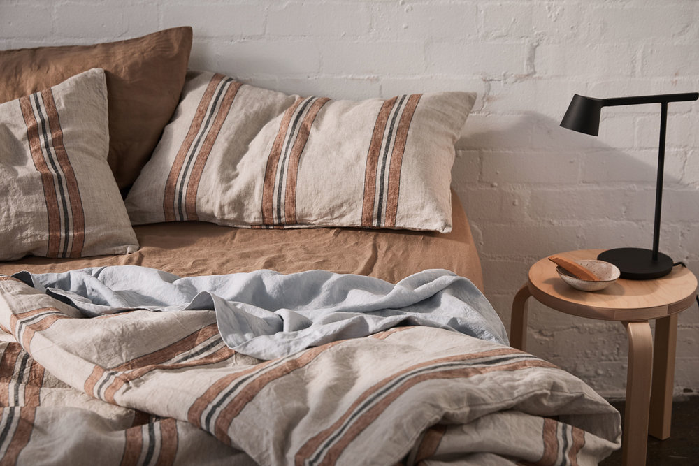 2    Linen Pillowslips, Duvet and Slips in Riad. Flat Sheet in Mist and Fitted Sheet in Chestnut from In Bed. Photo -  Terence Chin . Styling -  Imogene Roache
