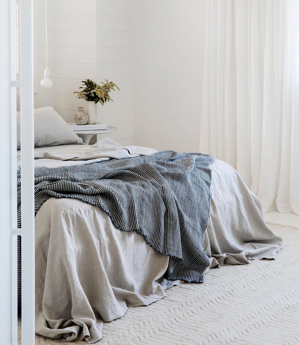 1    Queen Linen Sheet Set with Pillowcases in Natural and Mira Linen Throw in Ellis Stripe from Cultiver. Photo -  Chris Warnes . Styling  Jackie Brown