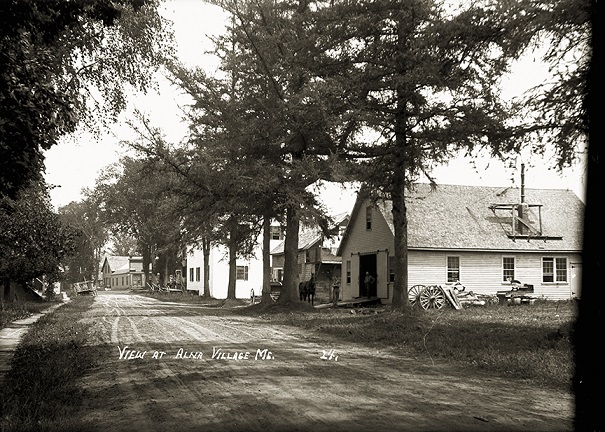 Dock Rd. Looking North to Hilton's Store c. 1910. The village blacksmith shop (now gone) is the building in the foreground on the right. This photo post card is from Eastern Publishing Co. whose collection of glass negatives is now housed at the Penobscot Marine Museum in Searsport.