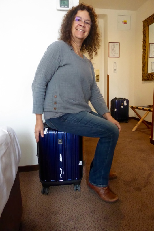 Little Vanna posing with the teeny-tiny Samsonite.
