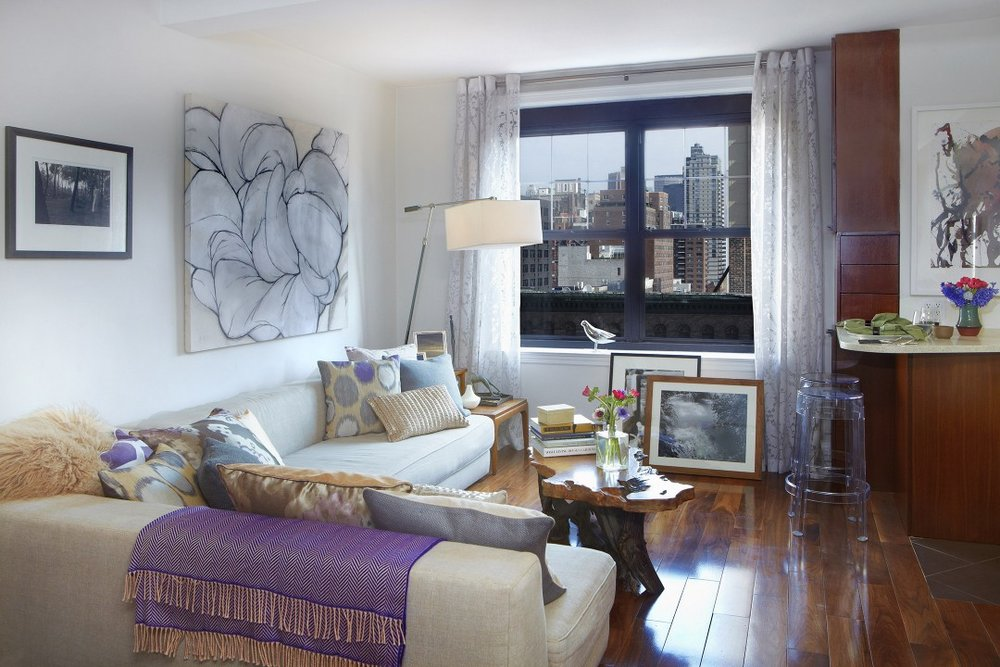 The room's layout is oriented toward the studio's best feature, its Manhattan view.