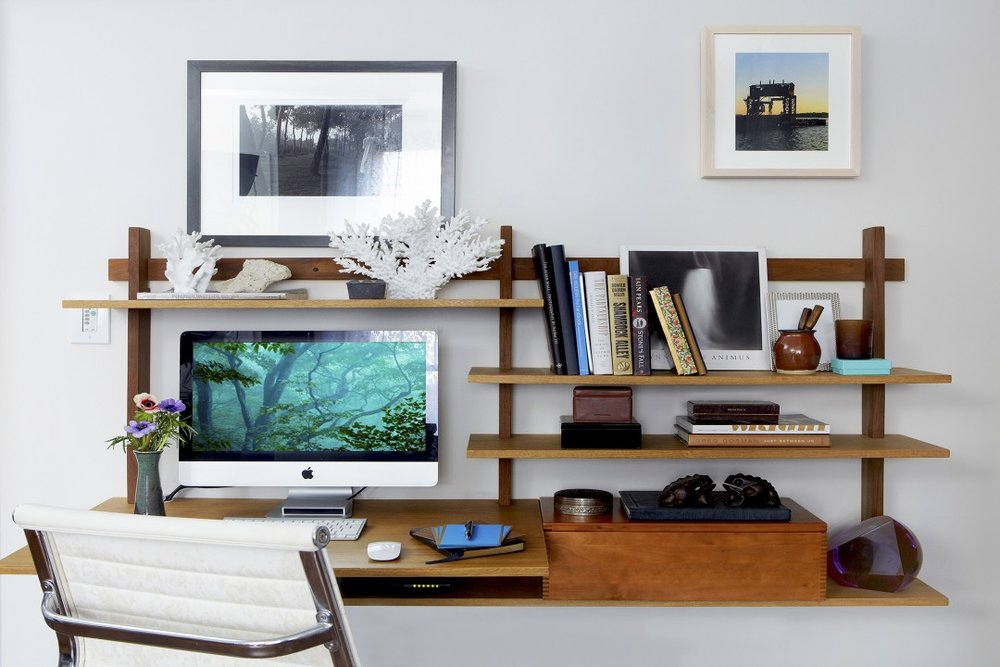A combination desk and bookshelf saves space.