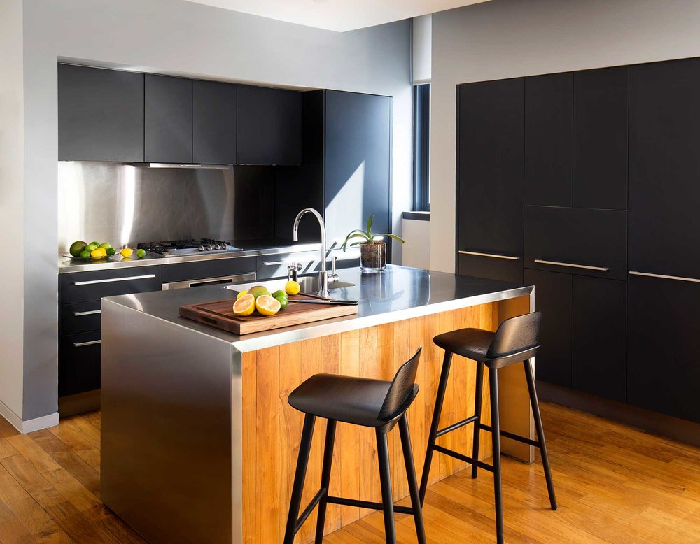 modern and stylish kitchen with island features bar type and large cabinets for storage