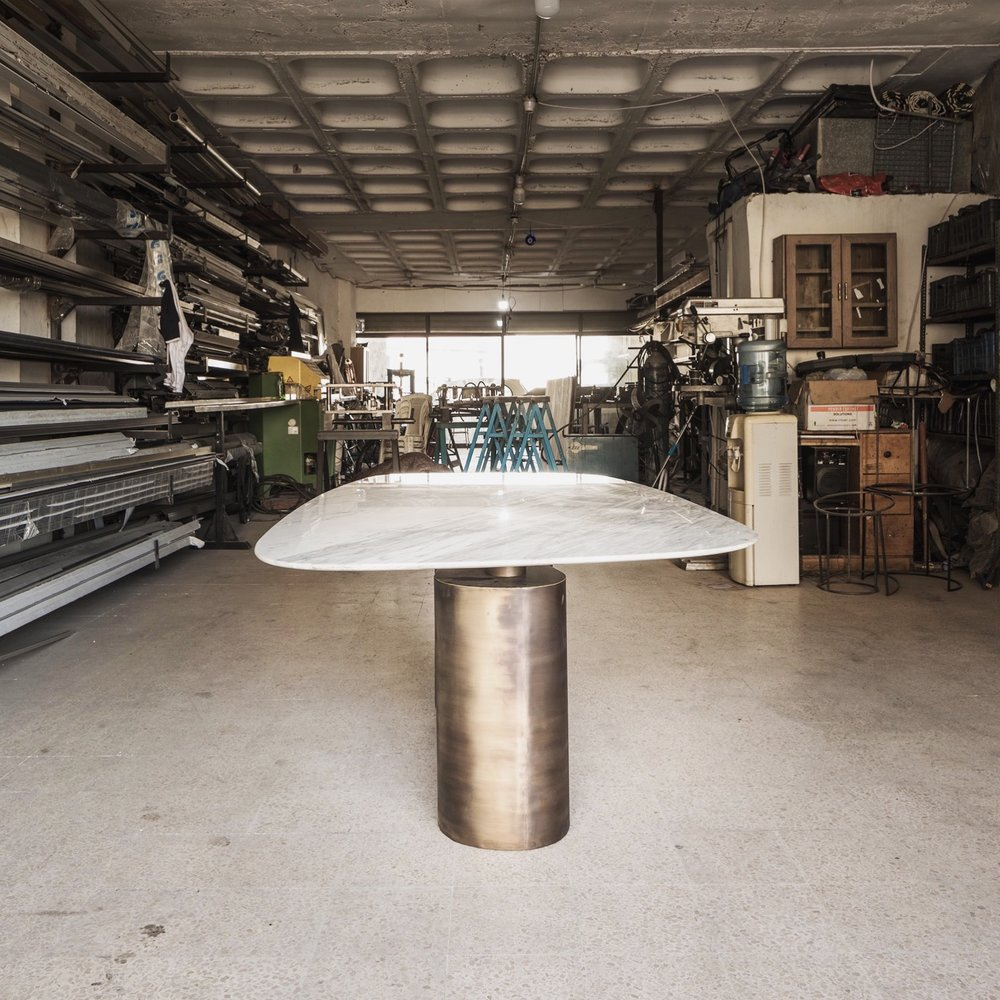 Strata   A dining table  Brass Footing  Marble - Statuario