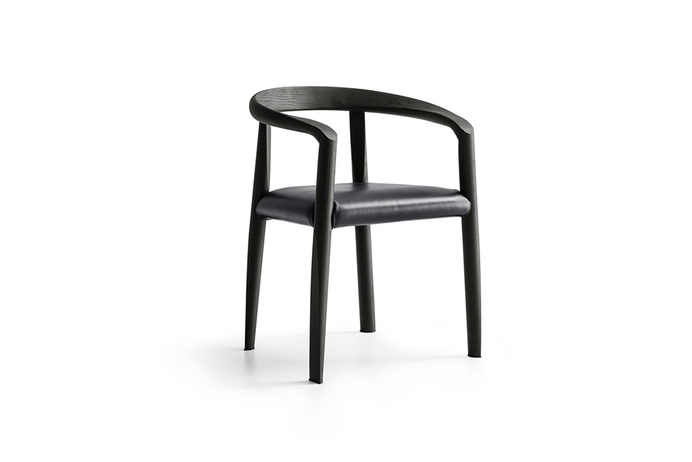MISS Tobia Scarpa Miss chair, designed by Afra and Tobia Scarpa in 1986. The form is linked to a system of soft, unbroken, linear rhythms. The seat is inserted between the lines and links them. Tobia Scarpa has re-designed the armrest joint to make the chair comfier and more linear.