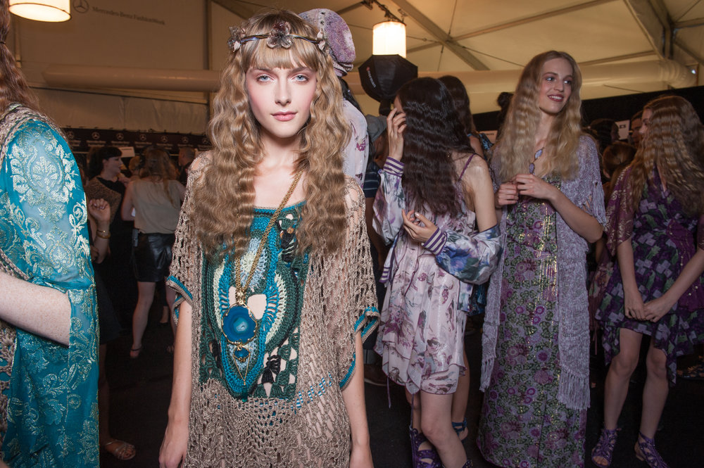Backstage at the Spring Summer 2014 Collection which was inspired in part by the Pre-Raphaelites: Victorian Avant Garde exhibition at the Tate in 2012 combined with the work of The Fool, the 1960s psychedelic design collective. Image © Raoul Gatchalian